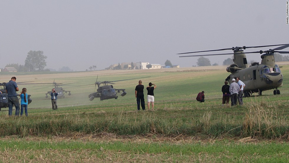 The U.S. helicopters take off after the landing.