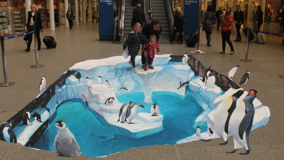 Shoppers get to take part in this 3D art in a shopping mall advertising for SeaWorld.