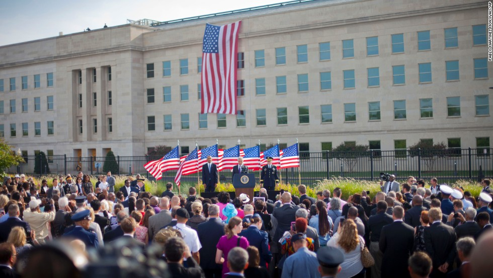 From left, U.S. President Barack Obama, U.S. Defense Secretary Chuck Hagel and Chairman of the Joint Chiefs of Staff Gen. Martin Dempsey stand on stage as they participate in a ceremony at the Pentagon.