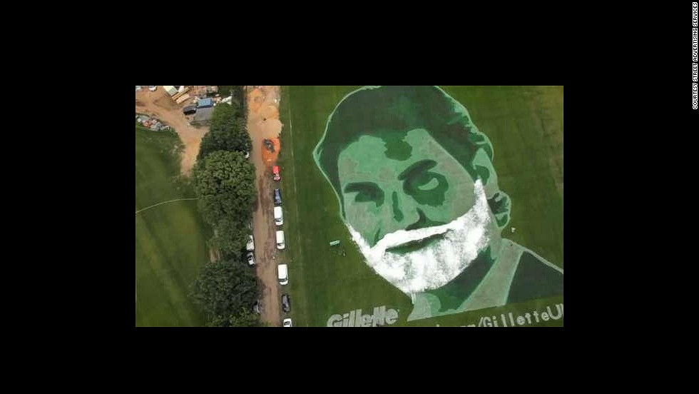 Street Advertising Services (SAS) uses grass advertizing as one of its techniques to grab attention. Roger Federer is seen here spray painted on a hill in Wimbledon during the tennis tournament in 2011.