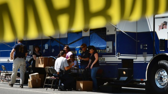 FBI agents work at a command post after raids were conducted in the fashion district of Los Angeles.