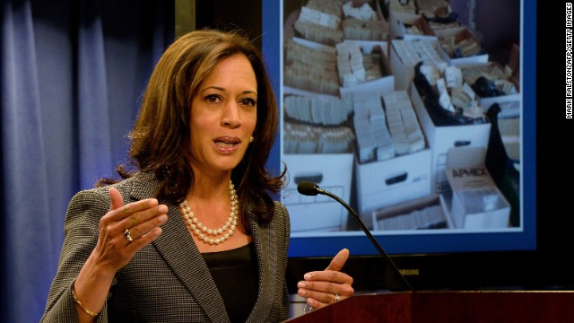 "California Attorney General Kamala Harris briefs the media after raids were conducted on money-laundering operations in the Fashion District of Los Angeles on September 10, 2014.  Police staged mass dawn raids in Los Angeles today dubbed ""Operation Fashion Police,"" seizing $65 million in cash and funds allegedly linked to money-laundering for Mexican drug cartels. Nine people were arrested as some 1,000 officers fanned out in the Fashion District in downtown LA, which one official called the ""epicenter of narco-dollar money laundering.""           AFP PHOTO/Mark RALSTON        (Photo credit should read )"