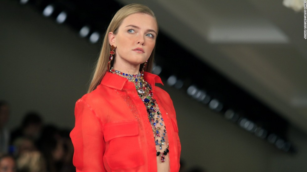 Ralph Lauren layered elaborate jewels under an orange safari jacket for another colorful statement.