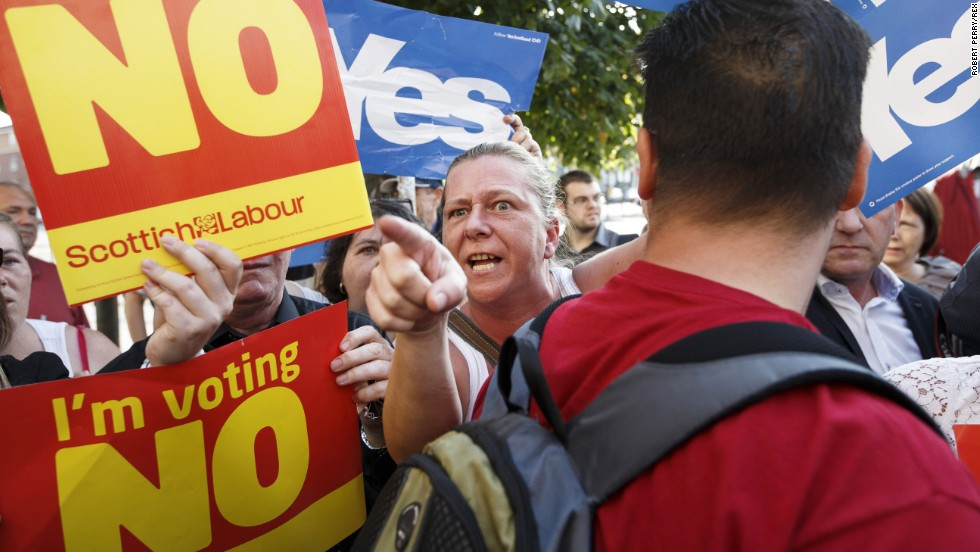 People campaigning for both sides of the independence referendum clash in Glasgow on Friday, September 12.