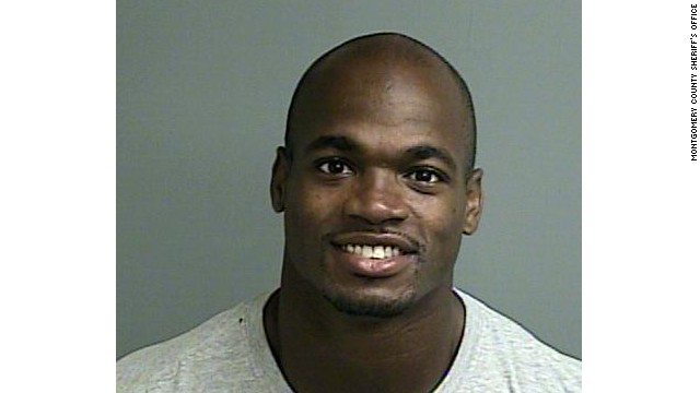 Adrian Peterson turned himself in early Saturday morning.