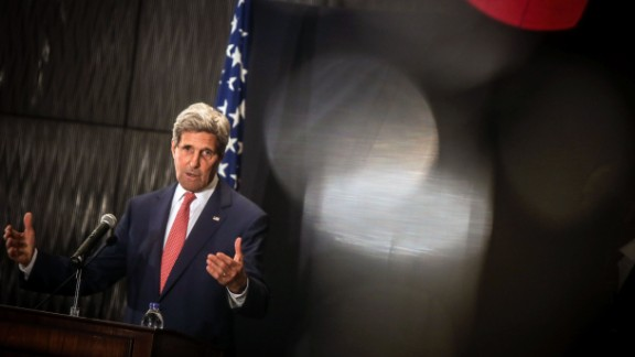 US Secretary of State John Kerry speaks during a joint press conference with Egyptian Foreign Minister Sameh Shoukry (unseen) on September 13, 2014 at the Fairmont Heliopolis Hotel in the capital Cairo. Kerry arrived in Cairo on the latest leg of a regional tour to forge a coalition against Islamic State jihadists in Iraq and Syria.
