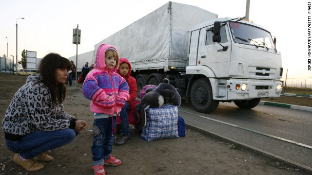Lorries, part of a Russian humanitarian convoy, cross the Ukrainian border on September 13.