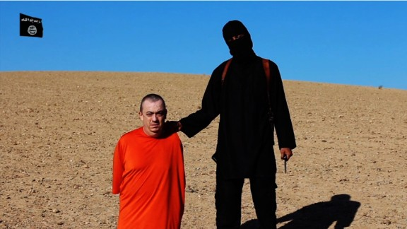 Alan Henning with an ISIS member in a frame taken from a video released by ISIS.