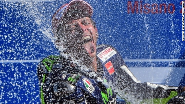 Valentino Rossi enjoys his champagne moment after claiming the San Marino MotoGP at Misano.