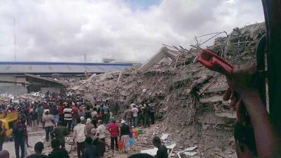 People search for survivors after a church building collapsed in Lagos, Nigeria.