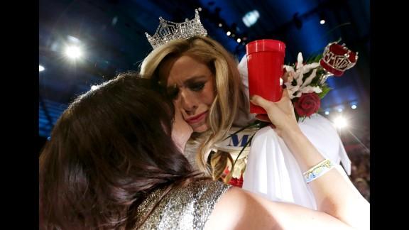 Kazantsev gets a kiss from her mother, Julia Kazantsev, after she was crowned.