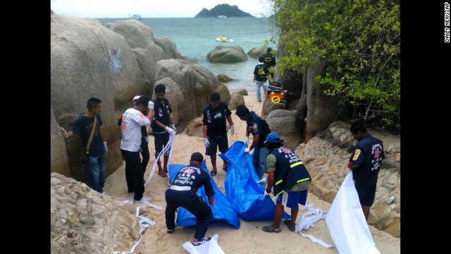 Thai police work near the bodies of two British tourists on a beach in the Surat Thani province of Thailand on Monday, September 15.