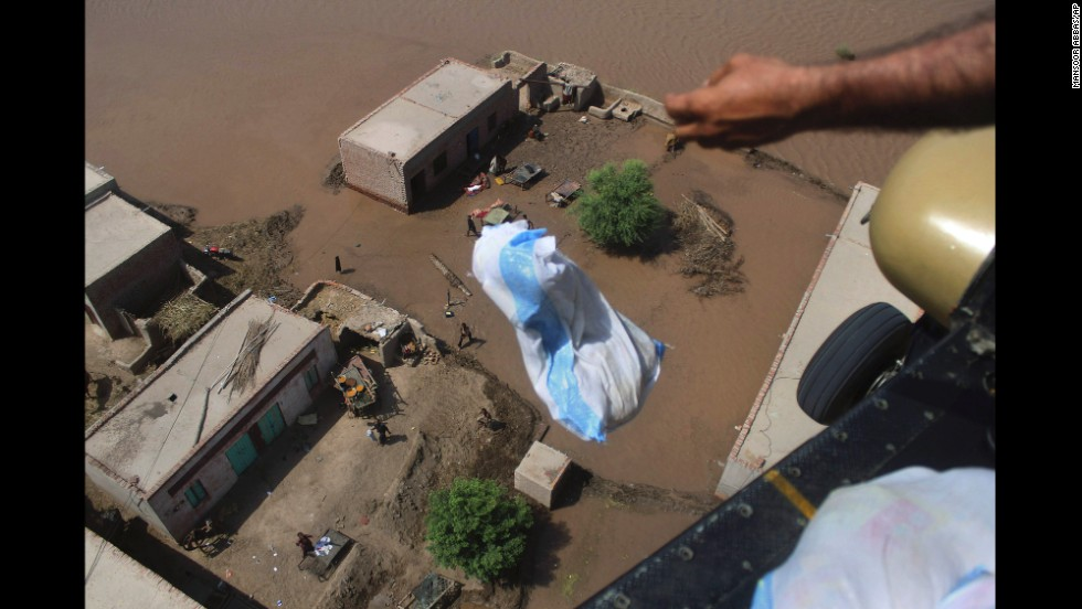 A Pakistani soldier drops relief goods in the flooded city of Multan, Pakistan, on Sunday, September 14.
