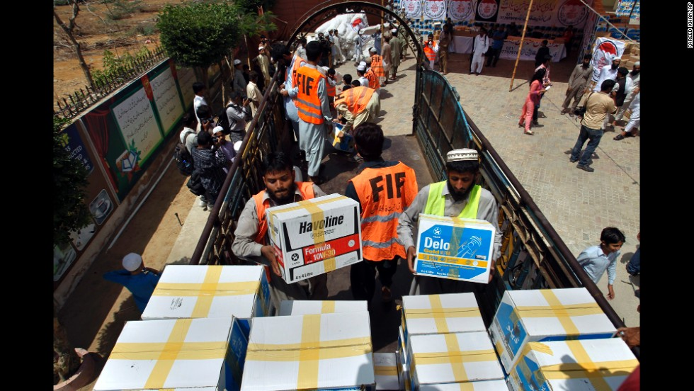 Members of a charity group load relief goods onto a truck in Karachi, Pakistan, on September 14.