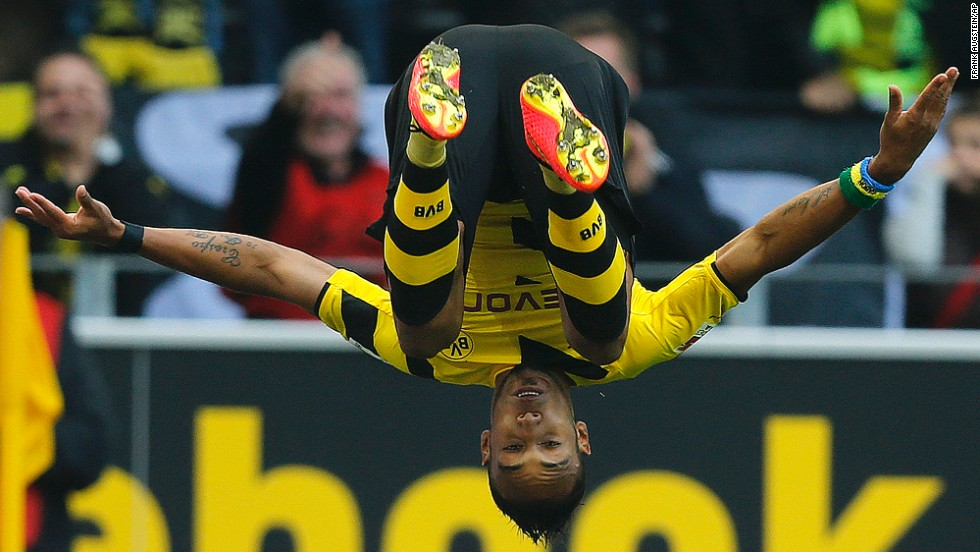 Pierre-Emerick Aubameyang of the German soccer club Borussia Dortmund celebrates with a flip after scoring a goal against Freiburg on Saturday, September 13, in Dortmund, Germany. Dortmund won the match 3-1.
