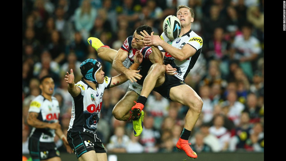 Matt Moylan of the Penrith Panthers, right, collides with Anthony Minichiello of the Sydney Roosters as they compete for a ball during a National Rugby League match in Sydney on Saturday, September 13. Penrith won 19-18 to advance to the league's preliminary finals.