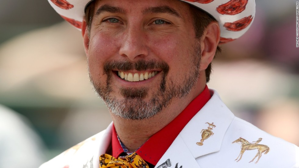 A race fan wearing a festive hat and suit attends the 140th running of the Kentucky Derby at Churchill Downs on May 3, 2014 in Louisville, Kentucky.