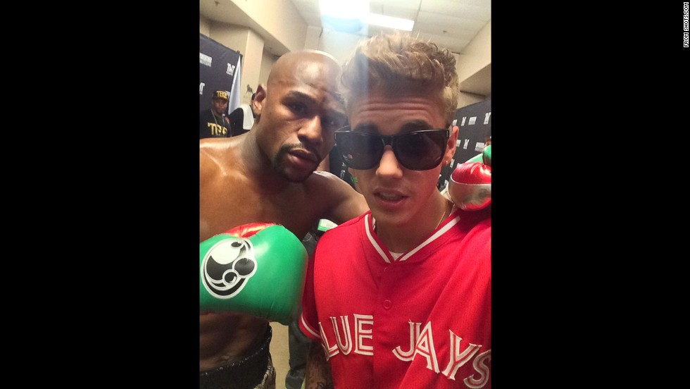 Mayweather, posing for a selfie with Justin Bieber, has invested in Shot, a photo-sharing social media application.