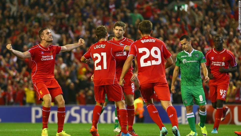 "Gerrard has been at the heart of the action at Anfield ever since he made his first team debut debut in 1998. The 34-year-old (center), seen here during a Champions League match against Ludogorets in September, said Friday he will carry on playing but not in the Premier League. ""I can't confirm at this stage where that will be, I can say it will be somewhere that means I won't be playing for a competing club and will not therefore be lining up against Liverpool -- that is something I could never contemplate."""