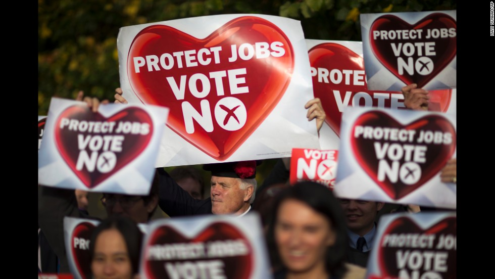 "People hold ""no"" banners during a pro-union rally in Edinburgh on Tuesday, September 16."