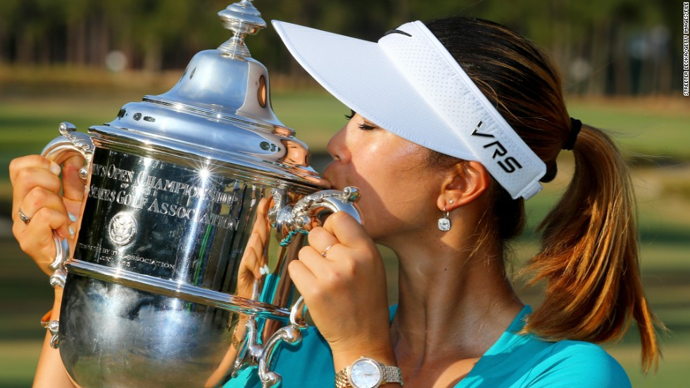 Wie kisses the trophy after finishing two shots clear of fellow American Stacy Lewis at Pinehurst in North Carolina.