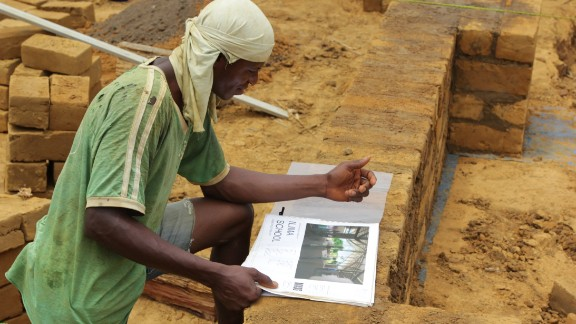 MASS Design worked with carpenters and masons in Ilima to pick up local knowledge of how to build with the region