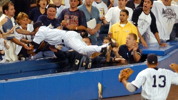 Jeter dives into the stands at Yankee Stadium to catch a foul ball in July 2004.