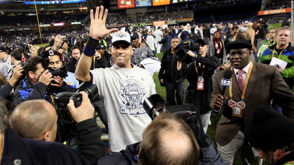 Jeter celebrates on the field after the Yankees won the 2009 World Series in New York. As Jeter's hand shows, this was his fifth world title with the Yankees.