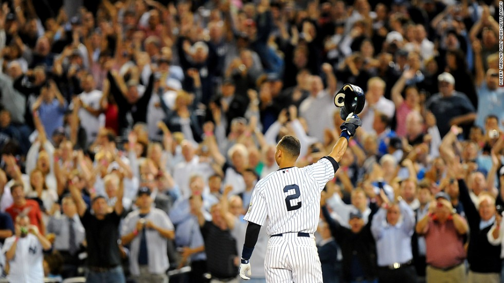 Jeter tips his helmet to an adoring crowd at the new Yankee Stadium after he tied the team record for career hits in September 2009. He would later go on to break that record, which had been held by Lou Gehrig.
