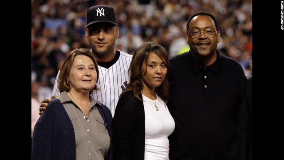 Jeter is seen with his mother, Dorothy; his sister, Sharlee; and his father, Charles, before the final regular-season game at the old Yankee Stadium in September 2008.