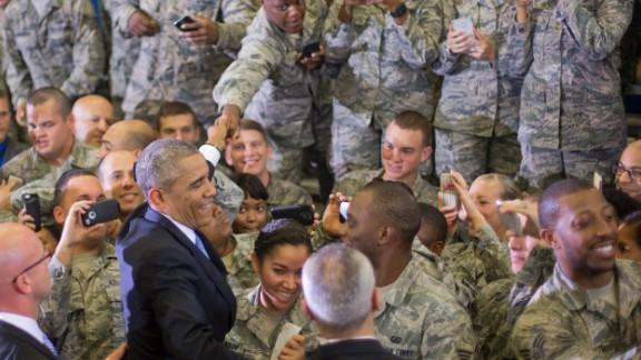 President Barack Obama reaches into the crowd to greet members of the military after speaking at US Central Command (CentCom) at MacDill Air Force Base, Fla., Wednesday, Sept. 17, 2014.