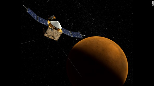 This artist's concept shows the MAVEN spacecraft with the planet Mars in the background.