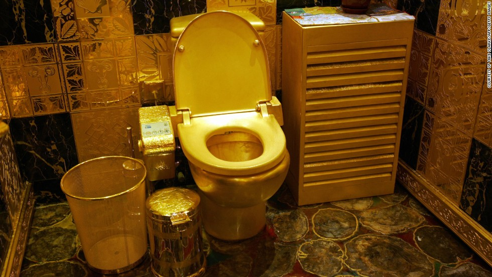 Toilets have been re-imagined in a number of outrageous ways throughout the years. This picture, taken in Hong Kong, shows a solid gold and gem-encrusted toilet valued at 38,000,000 million Hong Kong dollars (4.8 million USD).