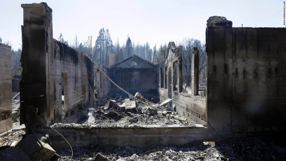 The shell of a library in Weed smolders on September 16.