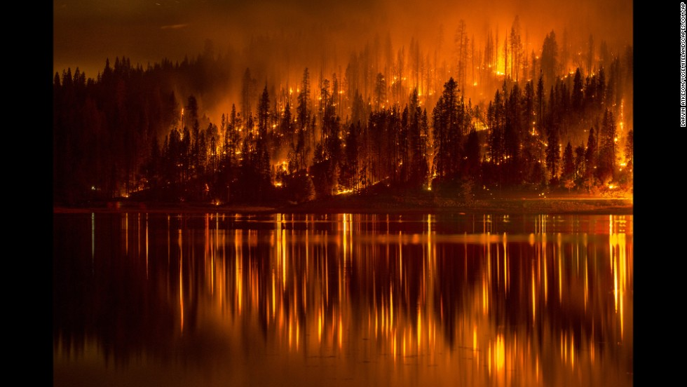 A wildfire approaches the shore of California's Bass Lake on Sunday, September 14.