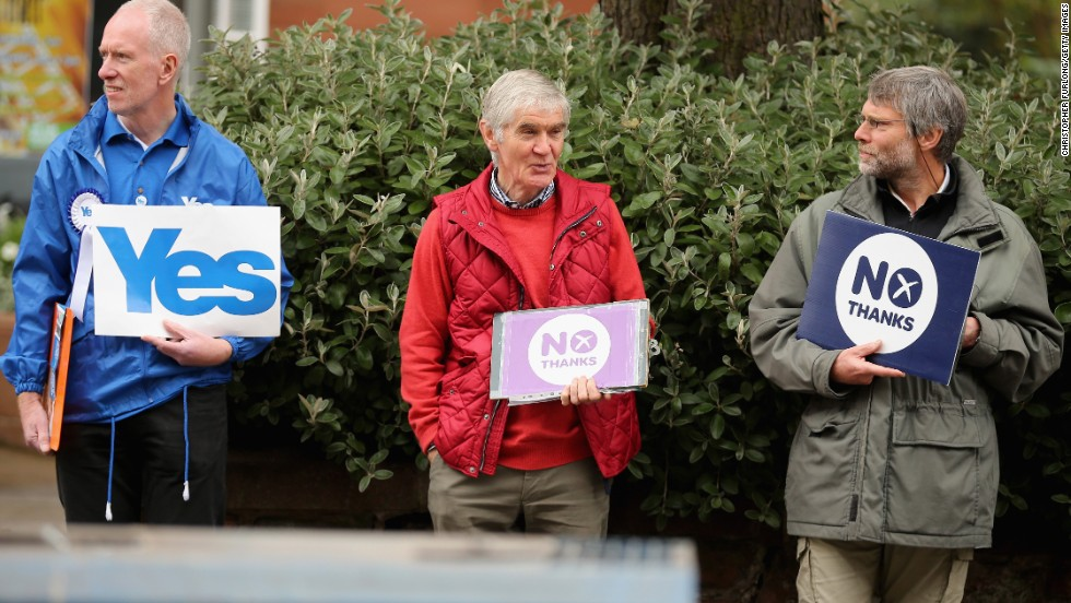 Campaigners on both sides of Scotland's independence referendum stand outside a polling station in Edinburgh on September 18.