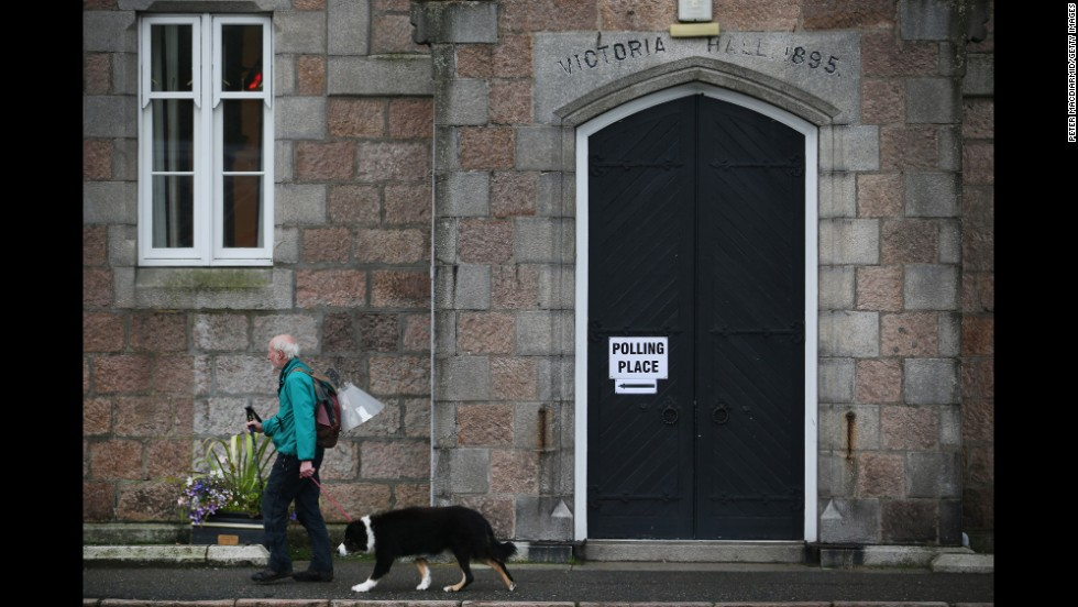 A man walks to a polling station to cast his vote in Ballater, Scotland, on September 18.