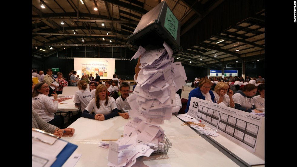 Ballot boxes are opened as counting begins Thursday, September 18, in Aberdeen, Scotland.