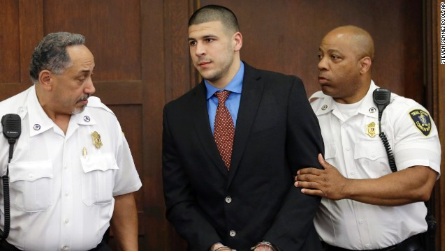 Former New England Patriots football player Aaron†Hernandez, center, is escorted by court officers as he enters Suffolk Superior Court before a hearing, Tuesday, June 24, 2014, in Boston. Prosecutors allege that Hernandez ambushed and shot to death two men, Daniel de Abreu and Safiro Furtado, in 2012 after a chance encounter inside a Boston nightclub. Hernandez has pleaded not guilty. (AP Photo/Steven Senne, Pool)