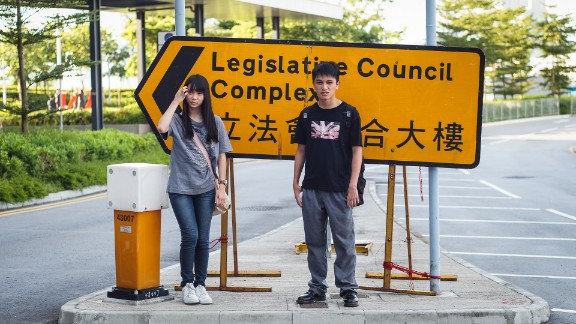 "17-year-old students Agnes Chow and Ivan Tan are members of Scholarism. ""After joining Scholarism, I"