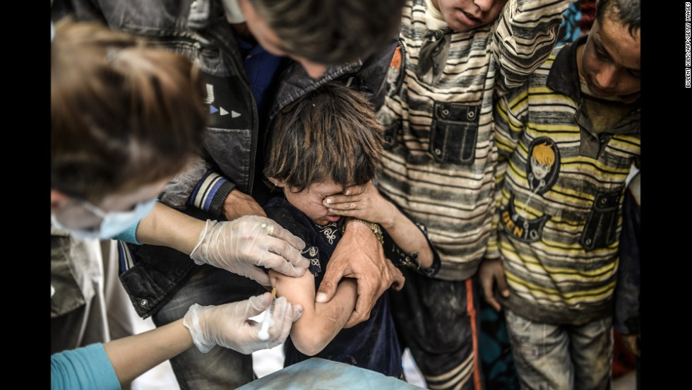 A Syrian Kurdish boy is vaccinated as he arrives in Suruc on September 23. The United Nations estimates that more than 2.5 million Syrians have fled their country since an uprising in March 2011 spiraled into civil war.