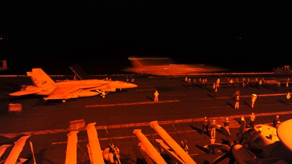 Two more U.S. fighter jets prepare to take off from the USS George H.W. Bush and conduct airstrikes against ISIS targets in Syria.