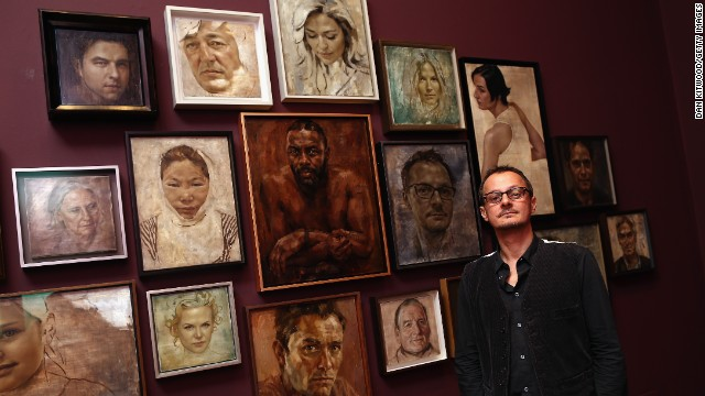 Caption:LONDON, ENGLAND - SEPTEMBER 10: Artist Jonathan Yeo poses in front of a selection of his celebrity portraits at the National Portrait Gallery on September 10, 2013 in London, England. The exhibition of celebrity portraits includes the first painted portrait of education activist Malala Yousafzai and will run from September 10, 2013 - January 5, 2014. (Photo by Dan Kitwood/Getty Images)