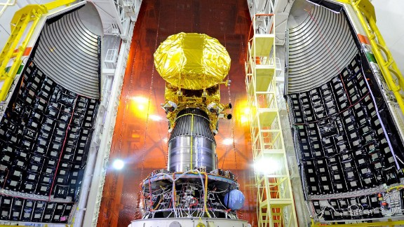 The Mars Orbiter spacecraft is pictured attached to the PSLV-C25 launch vehicle, with the heat shield open.