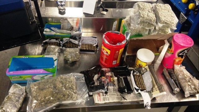 The TSA says a woman at John F. Kennedy International tried to smuggle weapons and marijuana in her luggage.