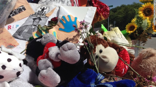 Before it burned Tuesday, the Michael Brown memorial consisted largely of stuffed animals and flowers.