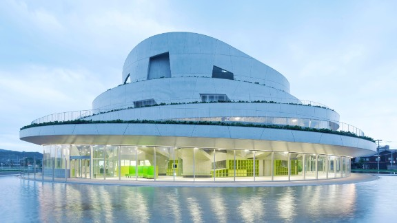 """Built on an old baseball field in Japan, Niigata City's <a href=""""http://www.akiha-bunka.jp/"""" target=""""_blank"""" target=""""_blank"""">Akiha Ward Cultural Center</a> is designed to blend in with nearby hills. The terraced design allows visitors a panoramic view. <br /><strong>Category: </strong>Culture<br /><strong>Architects: </strong>Chiaki Arai Urban and Architecture Design (Japan)"""