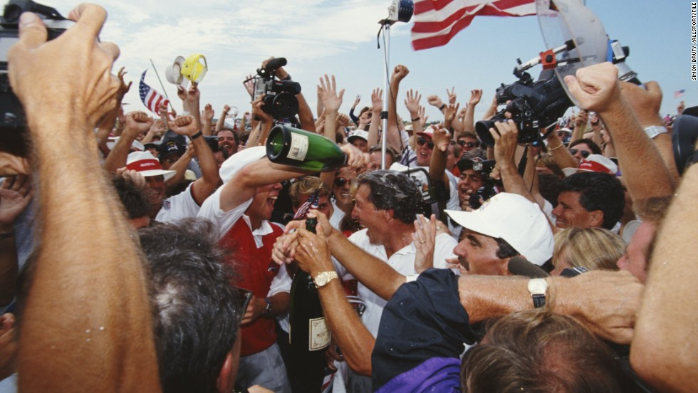"The U.S. has also enjoyed its fair share of Ryder Cup success. This picture shows Payne Stewart and Hale Irwin being mobbed by fans and covered in champagne after winning the 1991 match -- <a href=""http://www.golf.com/tour-and-news/1991-ryder-cup-war-shore-remembered-john-garrity"" target=""_blank"">a tense clash known as ""the War on the Shore.""</a>"