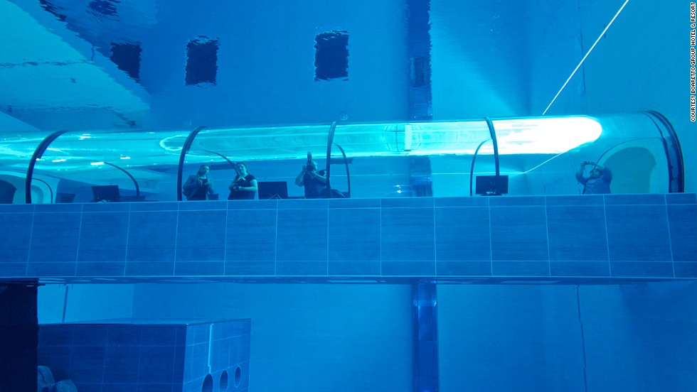 The pool also features caves to simulate sea floor environments.