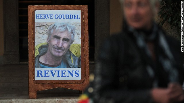 This picture taken on September 23, 2014 shows a poster depicting Herve Gourdel, in Saint-Martin-Vesubie, southeastern France.